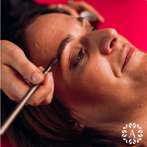 Application of henna brow dye to a model within the beauty academy
