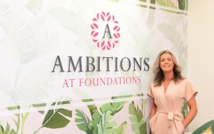 Julie stood by wall in Ambitions beauty academy